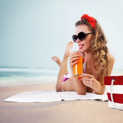 Pin-up girl on the beach; Shutterstock ID 184065995; PO: license(14264)